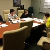 CGI President, Zach Chamberlain, smiles at the camera while members discuss the viability of a number of projects